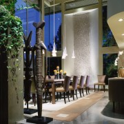 View of a large dining area. The room dining room, furniture, interior design, lobby, table, black, gray