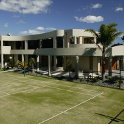 A house with a tennis court & landscaping architecture, estate, facade, home, house, property, real estate, residential area, brown
