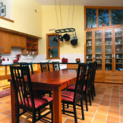 Kitchen with red gum dining table with black chair, dining room, floor, flooring, furniture, hardwood, interior design, kitchen, room, table, wood, orange