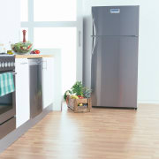 A kitchen featuring a large Westinghouse refrigerator. The floor, flooring, hardwood, home appliance, kitchen appliance, major appliance, product, refrigerator, white