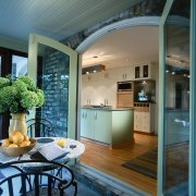 Kitchen leading out onto a covered patio. Outside: ceiling, countertop, home, interior design, kitchen, real estate, window