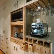 Kitchen designed for storage options. From left: pantry countertop, furniture, interior design, brown