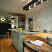 Kitchen with storage options. From the back (left), ceiling, countertop, interior design, kitchen, room, brown