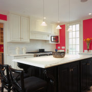 Kitchen with a bold color scheme. Hot pink cabinetry, ceiling, countertop, cuisine classique, flooring, interior design, kitchen, real estate, room, gray, black