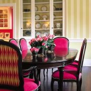 Bold color scheme. Dining room furniture hass been chair, dining room, furniture, home, interior design, kitchen & dining room table, living room, room, table, wall, window, window covering, orange, black