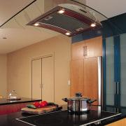 Kitchen with induction cooktop set into black benchtop ceiling, countertop, daylighting, interior design, kitchen, light fixture, lighting, under cabinet lighting, brown, orange