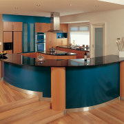 Kitchen with blue curved sides on cabinetry with cabinetry, countertop, desk, floor, flooring, furniture, hardwood, interior design, kitchen, laminate flooring, real estate, room, table, wood flooring, orange, brown