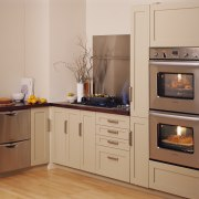 A kitchen featuring two Fisher & Paykel ovens. cabinetry, countertop, cuisine classique, home appliance, kitchen, kitchen appliance, kitchen stove, major appliance, oven, refrigerator, room, orange, brown