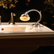 View of the soap holder within this bathroom lighting, product design, sink, still life photography, tap, black