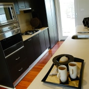 View of the kitchen - View of the countertop, furniture, home appliance, interior design, kitchen, room, black