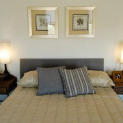 View of the bedroom - View of the bed, bed frame, bedroom, floor, furniture, home, interior design, living room, real estate, room, suite, gray