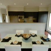 View of the dining room - View of interior design, kitchen, living room, property, real estate, room, table, gray