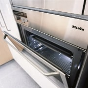 Close view of the Miele H387-1B KAT oven home appliance, kitchen appliance, major appliance, technology, white