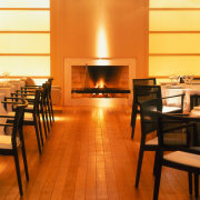 View of the dining area - View of fireplace, floor, flooring, furniture, hearth, interior design, table, wood, brown
