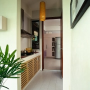 Apartment with a small wet kitchen, which includes interior design, real estate, yellow