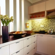 View of this kitchen area - View of cabinetry, countertop, cuisine classique, home, interior design, kitchen, room, tile, under cabinet lighting, brown, white