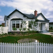 View of this classical hit - View of cottage, elevation, estate, facade, farmhouse, fence, home, home fencing, house, landscaping, neighbourhood, outdoor structure, picket fence, property, real estate, residential area, siding, window, yard, gray