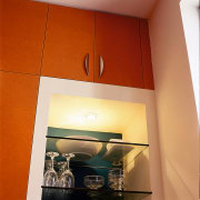 View of the cabinetry of this modern kitchen ceiling, interior design, light fixture, lighting, lighting accessory, orange, room, wall, red, orange