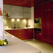 View of the kitchen's countertops - View of architecture, cabinetry, ceiling, countertop, interior design, kitchen, room, under cabinet lighting, red, orange