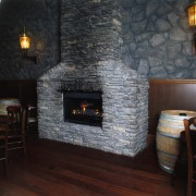 View of the fireplace - View of the fireplace, floor, flooring, hearth, home appliance, masonry oven, wall, wood burning stove, black