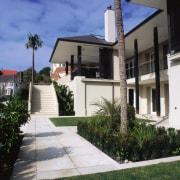 Large cream coloured stone tiles lead to front apartment, building, condominium, estate, facade, home, house, neighbourhood, property, real estate, residential area, villa, black