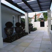 Entrance way to cream house with large sandstone courtyard, house, patio, property, real estate, window, gray, black
