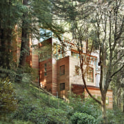 View of the home - View of the architecture, building, cottage, home, house, outdoor structure, plant, tree, brown