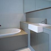view of bathroom - view of bathroom - bathroom, bathroom accessory, bathroom sink, floor, interior design, plumbing fixture, product design, property, room, sink, tap, tile, toilet seat, gray