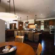 View of the kitchen & dining area - ceiling, countertop, flooring, hardwood, interior design, kitchen, living room, real estate, room, gray, black, brown
