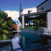 Black tiled spa pool looking over black swimming architecture, estate, home, house, property, real estate, reflection, residential area, sky, swimming pool, villa, water, blue, black