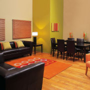 Interior view of lounge area - Interior view floor, flooring, furniture, interior design, living room, room, suite, table, orange, black