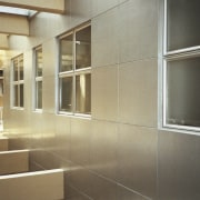 Interior view of a room - Interior view architecture, daylighting, floor, flooring, glass, interior design, lobby, property, real estate, tile, wall, window, brown