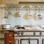 View of the kitchen accessories - View of cabinetry, countertop, cuisine classique, home appliance, interior design, kitchen, kitchen organizer, kitchen stove, room, sink, under cabinet lighting, gray, brown