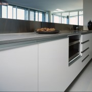 Kitchen with white cabinetry, grey benchtop and splashback, cabinetry, countertop, interior design, kitchen, gray