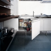 View of the cabinetry of this kitchen - countertop, floor, flooring, interior design, kitchen, white, black