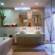 View of the bathroom with twin basins, bath, bathroom, ceiling, floor, interior design, room, sink, gray