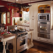View of the kitchen area of this home cabinetry, countertop, cuisine classique, home appliance, interior design, kitchen, kitchen appliance, kitchen stove, room, brown, red