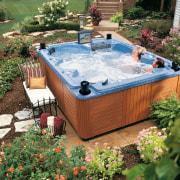 Broad view of this luxury spa bath - backyard, hot tub, leisure, swimming pool, water, yard, green, brown