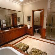 view of the bathroom, marble tiled flooring, wooden interior design, real estate, room, brown, orange