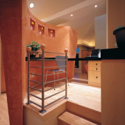 View of the kitchen area - View of cabinetry, ceiling, floor, flooring, handrail, hardwood, interior design, stairs, brown, orange