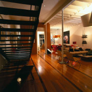 View of this living area - View of architecture, ceiling, floor, flooring, hardwood, interior design, laminate flooring, living room, loft, room, wood, wood flooring, brown, black