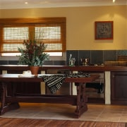 View of this kitchen - View of this cabinetry, desk, dining room, floor, flooring, furniture, hardwood, interior design, living room, room, table, wood, wood flooring, brown, black