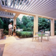 exterior view of outdoor living space under vergola backyard, estate, house, outdoor structure, patio, real estate, yard, gray