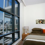Apartment bedroom with large windows and view of apartment, architecture, balcony, condominium, interior design, penthouse apartment, real estate, room, suite, window, gray, white