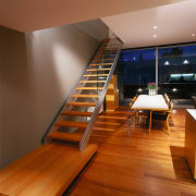 View of this home's main living area as architecture, floor, flooring, handrail, hardwood, interior design, stairs, wood, wood flooring, brown