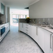 interior view of the kitchen and cabinets by countertop, floor, home, interior design, kitchen, real estate, room, gray
