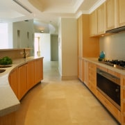 interior view of another kitchen by kitchen image cabinetry, countertop, cuisine classique, floor, flooring, hardwood, home, interior design, kitchen, laminate flooring, property, real estate, room, tile, wood, wood flooring, brown, orange
