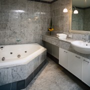 interior view of the bathroom and its fittings bathroom, bathtub, floor, interior design, room, tile, gray, black