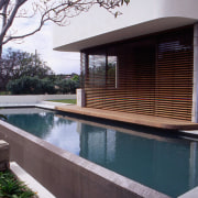 exterior of outdoor living area by poolside - architecture, backyard, home, house, outdoor structure, property, real estate, swimming pool, gray, black