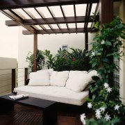 View of the outdoor living space with sofa backyard, courtyard, daylighting, furniture, interior design, living room, outdoor structure, patio, white, black